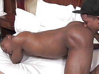Two black gay fellas licking each others ass in the hotel room