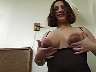 Horny bitch milking her huge boobs