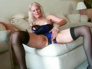 Sexy blonde granny toys her pussy before fucking
