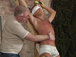 Hot gay sex Blindfolded, gagged, tormented and flogged, the boy is