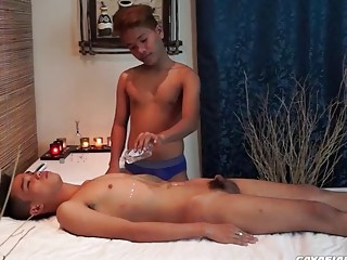 Asian gay boys with small peckers fuck on massage table