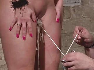 Busty slave Melanie Moon has her cunt and tits tortured