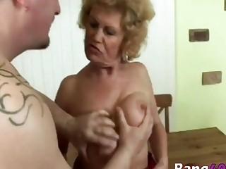 A slutty big tit granny masturbates and rides young stud's hard penis