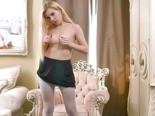 Cute blonde strips and wanks in nylon pantyhose