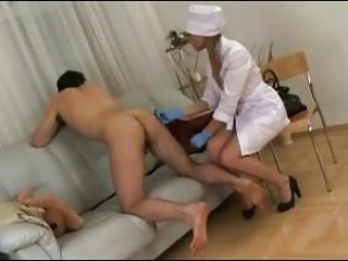 Russian nurse exams pussy licking patient's prostate with a strap-on