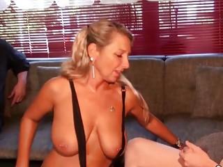 German MILF with big tits sucks dick and receives facial