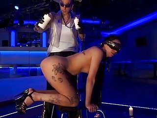 Submissive masked brunette feels the pain when waxed while dominated