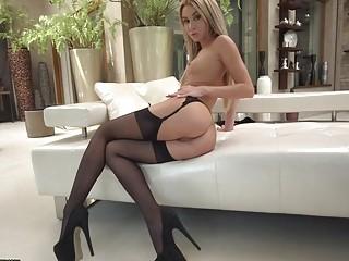 Glamorous blonde in high heels and stockings enjoys sensual anal