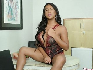 Shemale Rayra Spanick Masturbates Lustfully While a Dildo Stretches Her Ass