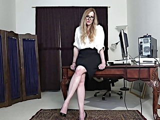 Mature office babe with blonde hair and glasses strokes pussy
