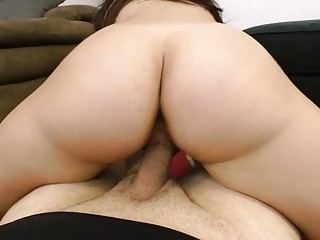 Brunette gets her pussy fingered before riding a hard cock