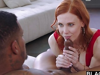 Redhead with blue eyes gets drilled by big black cock