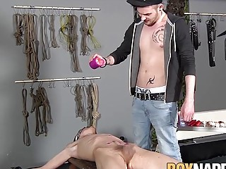 Blindfolded twink sucks cock while being punished with wax